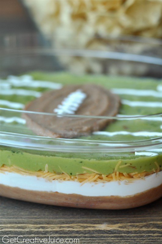 Football party layered dip - football and field