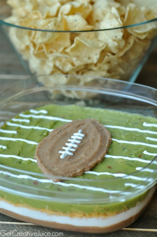 Football party or Superbowl Party layered dip football and field