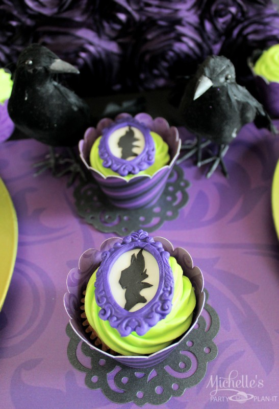 Maleficent party silhouette frame cookies on cupcakes