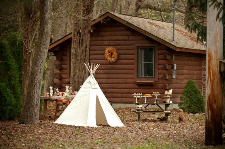 Rustic backyard kids thanksgiving, cabin backdrop, teepee, dessert table, table set up