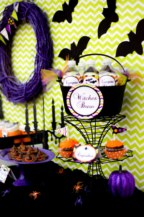 spooktacular halloween party,  chevron backdrop, black bats, witches brew, cupcakes