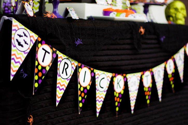 spooktacular halloween party, black ruffle tablecloth, trick or treat banner, polka dot and chevron, black bats, spiders