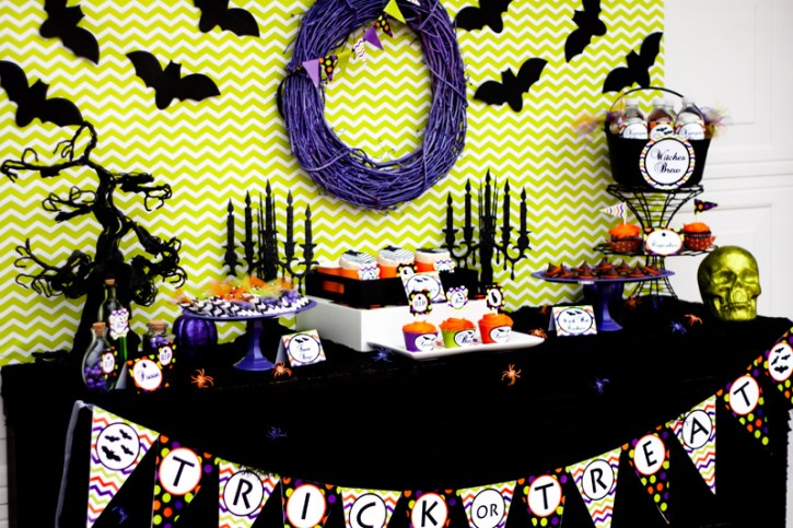 spooktacular halloween party, full dessert table, trick or treat banner, glittered skull, black candlelabras, purple wreath, spooky tree, black bats