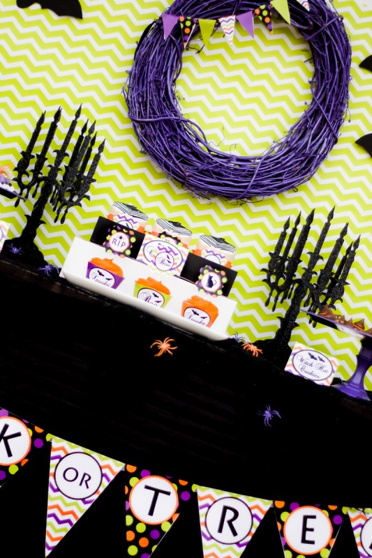 spooktacular halloween party, purple wreath, mini bunting, chevron backdrop, black candlelabras, cupcakes and cookies